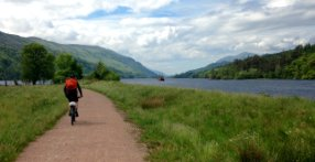Riding a mountain bike on the Great Glen Way between Inverness and Fort William, Scotland UK